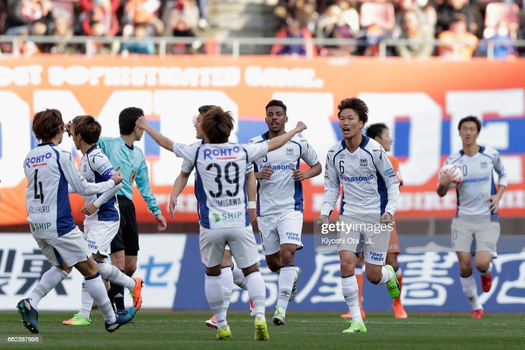 Kim Jungya (2nd R) of Gamba celebrates scoring his side's second goal with his team mates during the J.League J1 match between Albirex Niigata and Gamba Osaka at Denka Big Swan Stadium on April 1, 2017 in Niigata, Japan.
