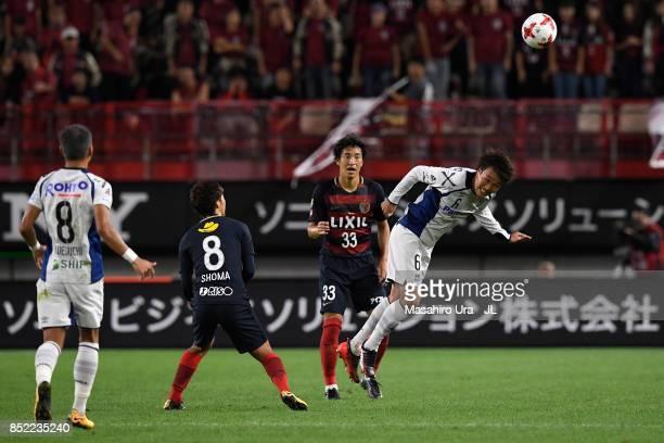 Kim Jungya of Gamba Osaka nad Mu Kanazaki of Kashima Antlers compete for the ball during the JLeague J1 match between Kashima Antlers and Gamba Osaka...