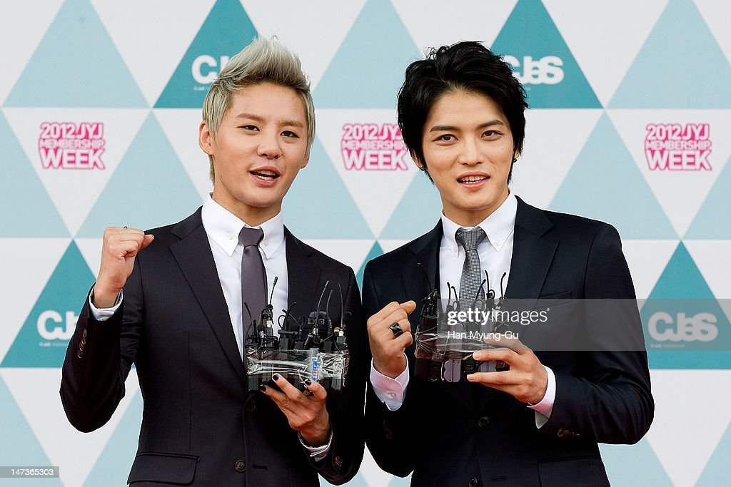 Kim Jun-Su and Kim Jae-Joong of South Korean boy band <a gi-track='captionPersonalityLinkClicked' href=/galleries/search?phrase=JYJ&family=editorial&specificpeople=3039772 ng-click='$event.stopPropagation()'>JYJ</a> attend during the '2012 <a gi-track='captionPersonalityLinkClicked' href=/galleries/search?phrase=JYJ&family=editorial&specificpeople=3039772 ng-click='$event.stopPropagation()'>JYJ</a> Membership Week' opening ceremony held at Setec on June 28, 2012 in Seoul, South Korea. The 2012 <a gi-track='captionPersonalityLinkClicked' href=/galleries/search?phrase=JYJ&family=editorial&specificpeople=3039772 ng-click='$event.stopPropagation()'>JYJ</a> Membership Week will host 15,000 Korean fans along with 7,024 Japanese fans that will visit South Korea to attend the large-scale fan event.