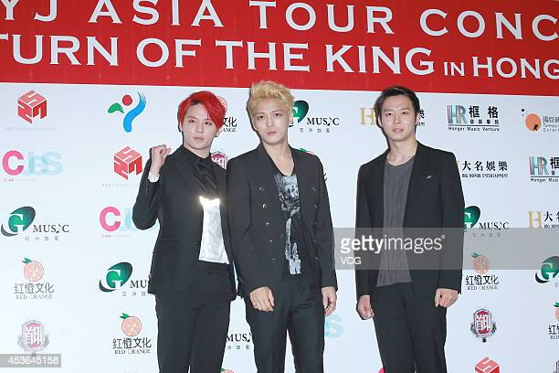 Kim JunSu Kim JaeJoong and Park YooChun of South Korean boy band JYJ attend a press conference ahead of concert at AsiaWorldExpo on August 15 2014 in...