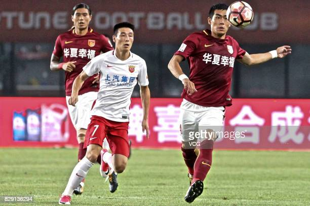 Kim Juyoung of Hebei China Fortune and Wu Lei of Shanghai SIPG vie for the ball during the 21st round match of 2017 China Super League between Hebei...