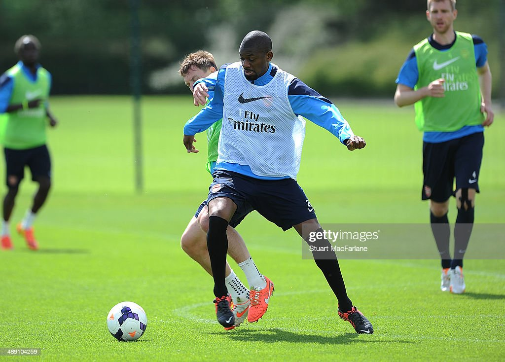 Kim Kallstrom and Abou Diaby of Arsenal during a training session at London Colney on May 10, 2014 in St Albans, England.