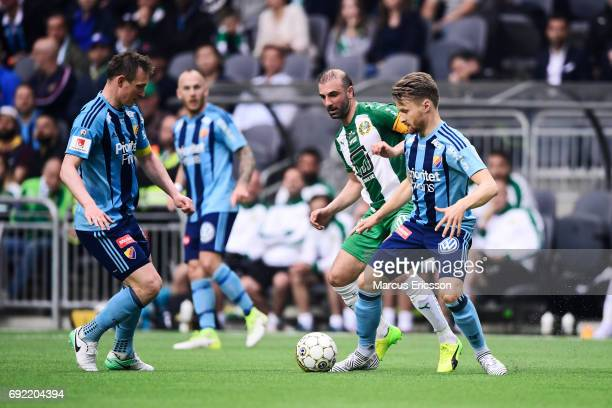 Kim Kallstrom and Jacob Une Larsson of Djurgardens IF and Kennedy Bakircioglu of Hammarby IF during the Allsvenskan match between Hammarby IF and...