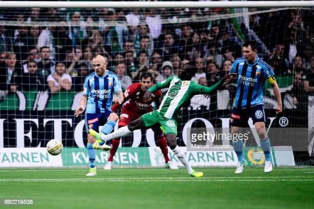 Kim Kallstrom and Magnus Eriksson of Djurgardens IF and Pa Amat Dibba competes for the ball during the Allsvenskan match between Hammarby IF and...