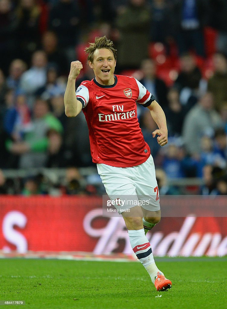 <a gi-track='captionPersonalityLinkClicked' href=/galleries/search?phrase=Kim+Kallstrom&family=editorial&specificpeople=539780 ng-click='$event.stopPropagation()'>Kim Kallstrom</a> of Arsenal celebrates scoring in the penalty shoot during the FA Cup Semi-Final match between Wigan Athletic and Arsenal at Wembley Stadium on April 12, 2014 in London, England.