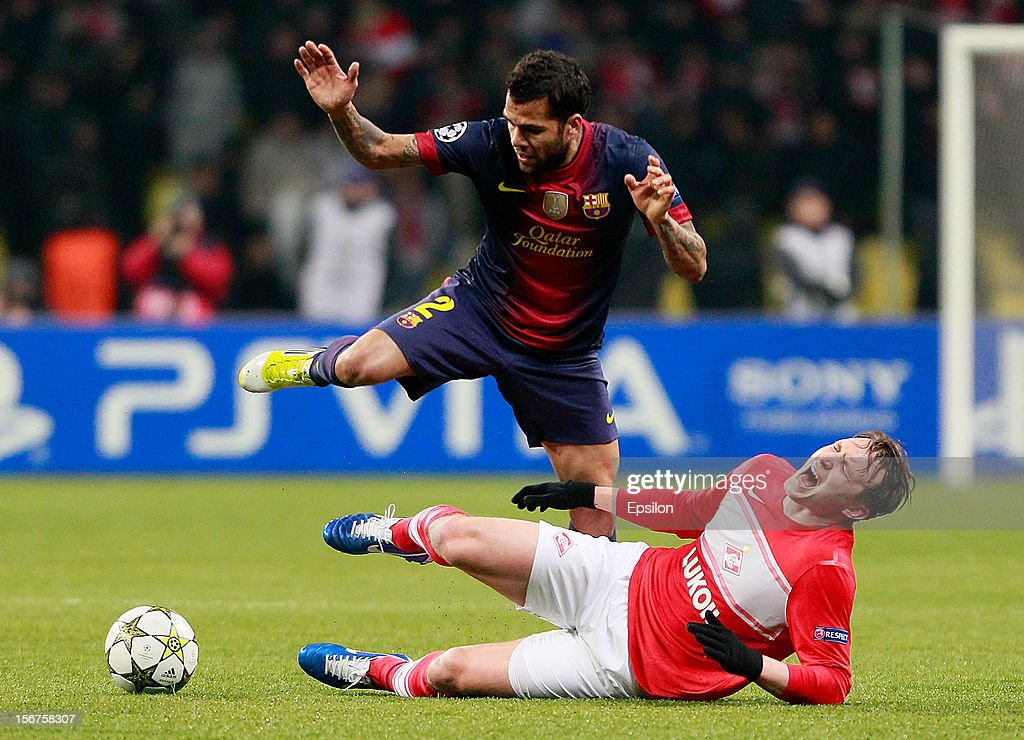Kim Kallstrom of FC Spartak Moscow battles for the ball with Dani Alves (Top) of FC Barcelona during the UEFA Champions League group G match between FC Spartak Moscow and FC Barcelona at the Luzhniki Stadium on November 20, 2012 in Moscow, Russia.