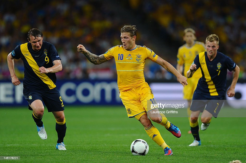 Kim Kallstrom of Sweden chases down Andriy Voronin of Ukraine during the UEFA EURO 2012 group D match between Ukraine and Sweden at The Olympic...