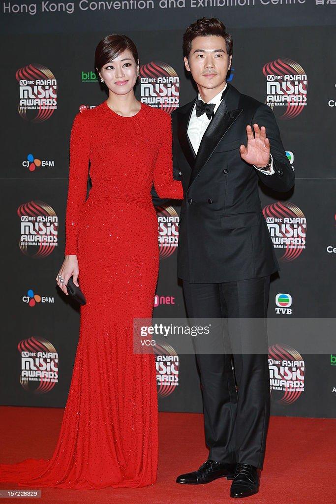 Kim Kang Woo(L) and Kim Hyo-jin arrive at the red carpet of the 2012 Mnet Asian Music Awards at Hong Kong Convention & Exhibition Center on November 30, 2012 in Hong Kong, China.