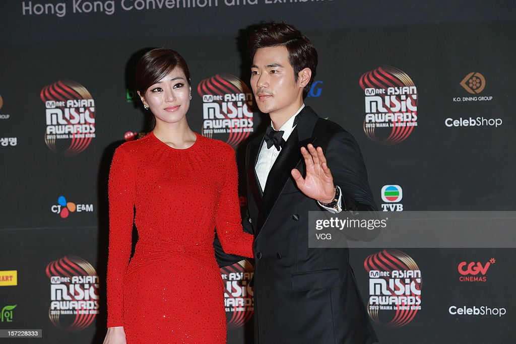 Kim Kang Woo(L) and Kim Hyo-jin arrive at the red carpet of the 2012 Mnet Asian Music Awards at Hong Kong Convention & Exhibition Center on November 30, 2012 in Hong Kong, China.