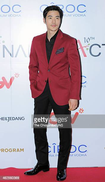 Kim KangWoo poses for photographs during the Nammoactors 10th anniversary party at Cheongdam CGV on January 10 2014 in Seoul South Korea