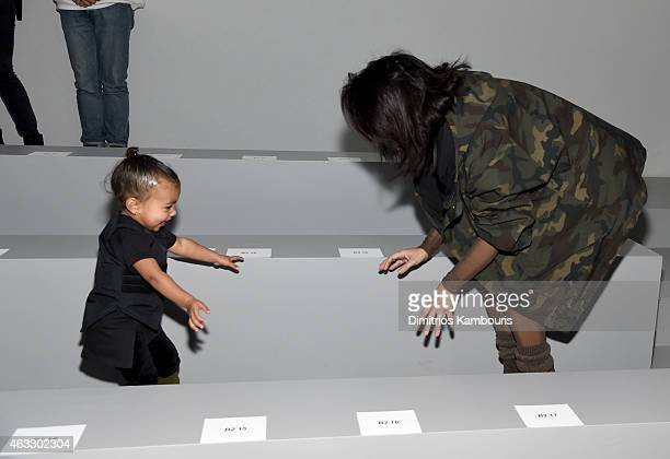 Kim Kardashian and daughter North attend the adidas Originals x Kanye West YEEZY SEASON 1 fashion show during New York Fashion Week Fall 2015 at...