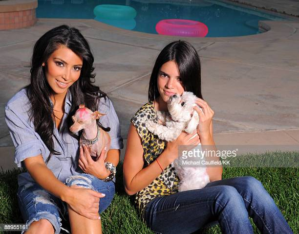 ACCESS*** Kim Kardashian and dog Dolce pose with sister Kendall Jenner and dog Bella during a photo shoot on July 7 2009 in Los Angeles California