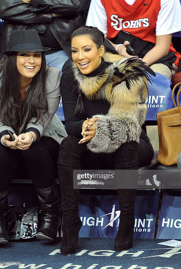 <a gi-track='captionPersonalityLinkClicked' href=/galleries/search?phrase=Kim+Kardashian&family=editorial&specificpeople=753387 ng-click='$event.stopPropagation()'>Kim Kardashian</a> and guest (L) attend the Miami Heat vs NJ Nets Game at Prudential Center on October 31, 2010 in Newark City.