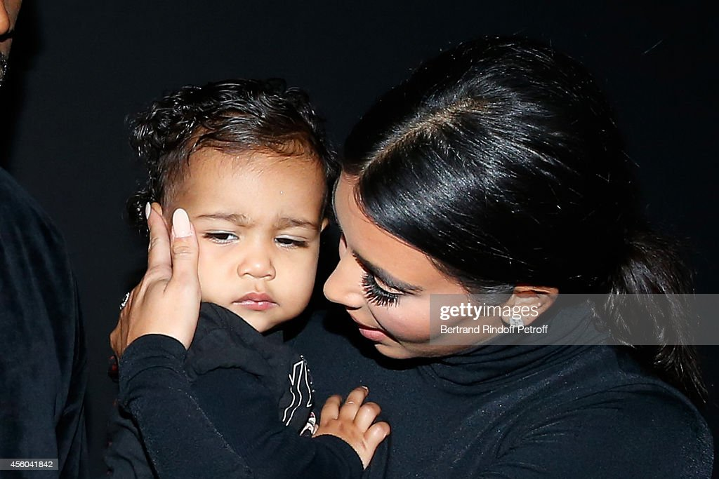 Kim Kardashian and her daughter North West attend the Balenciaga show as part of the Paris Fashion Week Womenswear Spring/Summer 2015 on September 24, 2014 in Paris, France.
