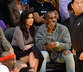 Kim Kardashian and her husband Kanye West attend a basketball game between the Houston Rockets and the Los Angeles Lakers at Staples Center on...