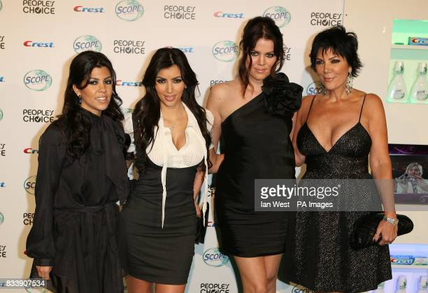 Kim Kardashian and her sisters arrive at the 34th People's Choice Awards nominations party at the Area Nightclub in Los Angeles