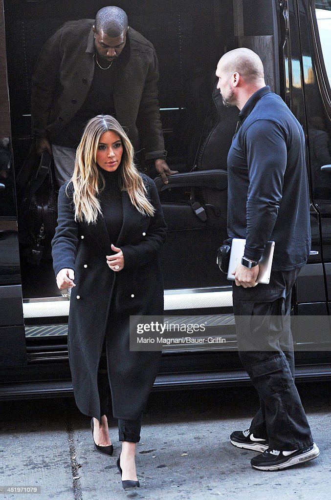 <a gi-track='captionPersonalityLinkClicked' href=/galleries/search?phrase=Kim+Kardashian&family=editorial&specificpeople=753387 ng-click='$event.stopPropagation()'>Kim Kardashian</a> and <a gi-track='captionPersonalityLinkClicked' href=/galleries/search?phrase=Kanye+West+-+Musician&family=editorial&specificpeople=201803 ng-click='$event.stopPropagation()'>Kanye West</a> are seen arriving at their apartment building on November 25, 2013 in New York City.