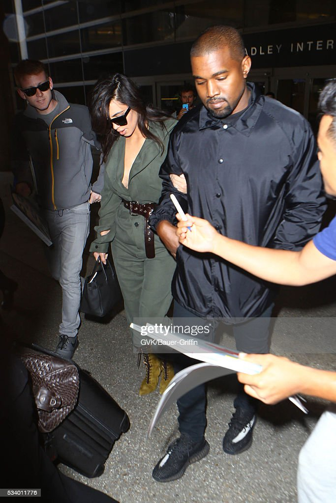 <a gi-track='captionPersonalityLinkClicked' href=/galleries/search?phrase=Kim+Kardashian&family=editorial&specificpeople=753387 ng-click='$event.stopPropagation()'>Kim Kardashian</a> and <a gi-track='captionPersonalityLinkClicked' href=/galleries/search?phrase=Kanye+West+-+Musiker&family=editorial&specificpeople=201803 ng-click='$event.stopPropagation()'>Kanye West</a> are seen at LAX on May 24, 2016 in Los Angeles, California.