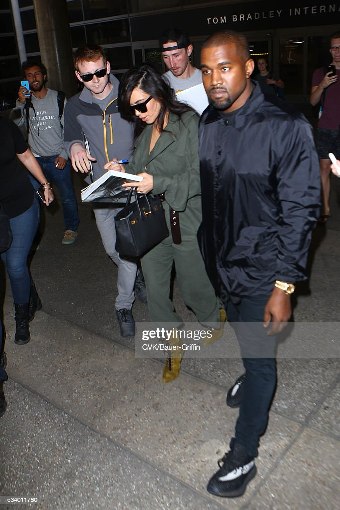 Kim Kardashian and Kanye West are seen at LAX on May 24, 2016 in Los Angeles, California.