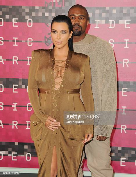 Kim Kardashian and Kanye West arrive at the 2015 MTV Video Music Awards at Microsoft Theater on August 30 2015 in Los Angeles California