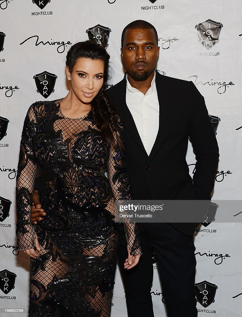 <a gi-track='captionPersonalityLinkClicked' href=/galleries/search?phrase=Kim+Kardashian&family=editorial&specificpeople=753387 ng-click='$event.stopPropagation()'>Kim Kardashian</a> and <a gi-track='captionPersonalityLinkClicked' href=/galleries/search?phrase=Kanye+West+-+Musician&family=editorial&specificpeople=201803 ng-click='$event.stopPropagation()'>Kanye West</a> arrive for the New Year's Eve countdown at 1 OAK Nightclub at The Mirage Hotel & Casino on December 31, 2012 in Las Vegas, Nevada.