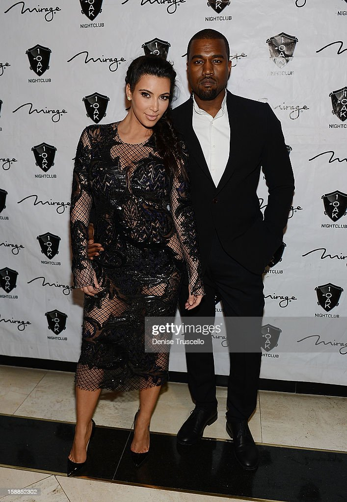 Kim Kardashian and Kanye West arrive for the New Year's Eve countdown at 1 OAK Nightclub at The Mirage Hotel & Casino on December 31, 2012 in Las Vegas, Nevada.