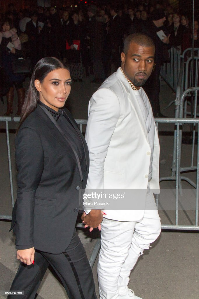 <a gi-track='captionPersonalityLinkClicked' href=/galleries/search?phrase=Kim+Kardashian&family=editorial&specificpeople=753387 ng-click='$event.stopPropagation()'>Kim Kardashian</a> and <a gi-track='captionPersonalityLinkClicked' href=/galleries/search?phrase=Kanye+West+-+Musician&family=editorial&specificpeople=201803 ng-click='$event.stopPropagation()'>Kanye West</a> arrive to attend the 'Givenchy' Fall/Winter 2013 Ready-to-Wear show as part of Paris Fashion Week on March 3, 2013 in Paris, France.