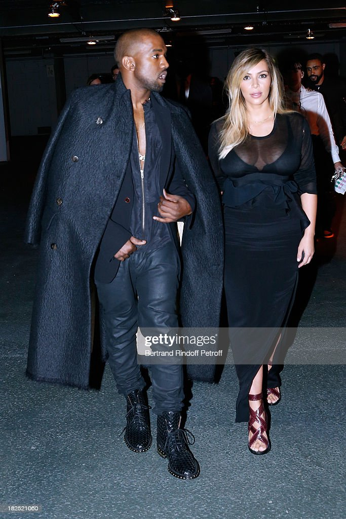 <a gi-track='captionPersonalityLinkClicked' href=/galleries/search?phrase=Kim+Kardashian&family=editorial&specificpeople=753387 ng-click='$event.stopPropagation()'>Kim Kardashian</a> and <a gi-track='captionPersonalityLinkClicked' href=/galleries/search?phrase=Kanye+West+-+Musician&family=editorial&specificpeople=201803 ng-click='$event.stopPropagation()'>Kanye West</a> arriving at Givenchy show as part of the Paris Fashion Week Womenswear Spring/Summer 2014, held at 'la Halle Freyssinet' on September 29, 2013 in Paris, France.