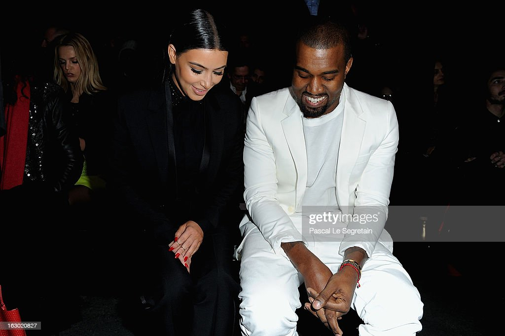 Kim Kardashian and Kanye West attend Givenchy Fall/Winter 2013 Ready-to-Wear show as part of Paris Fashion Week on March 3, 2013 in Paris, France.