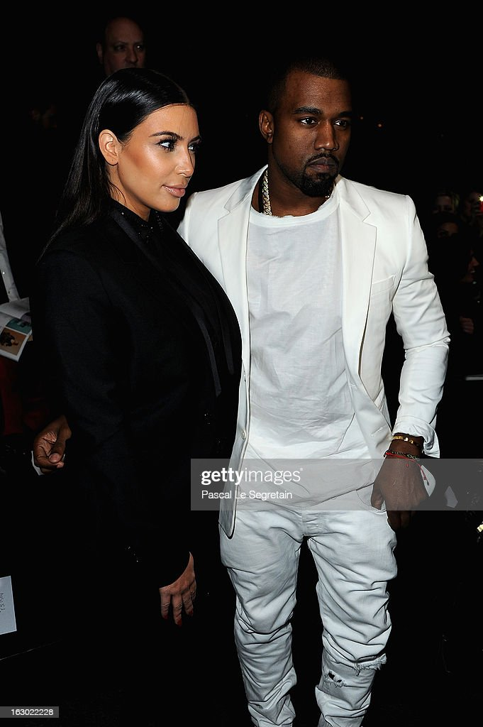 <a gi-track='captionPersonalityLinkClicked' href=/galleries/search?phrase=Kim+Kardashian&family=editorial&specificpeople=753387 ng-click='$event.stopPropagation()'>Kim Kardashian</a> and <a gi-track='captionPersonalityLinkClicked' href=/galleries/search?phrase=Kanye+West+-+Musicien&family=editorial&specificpeople=201803 ng-click='$event.stopPropagation()'>Kanye West</a> attend Givenchy Fall/Winter 2013 Ready-to-Wear show as part of Paris Fashion Week on March 3, 2013 in Paris, France.