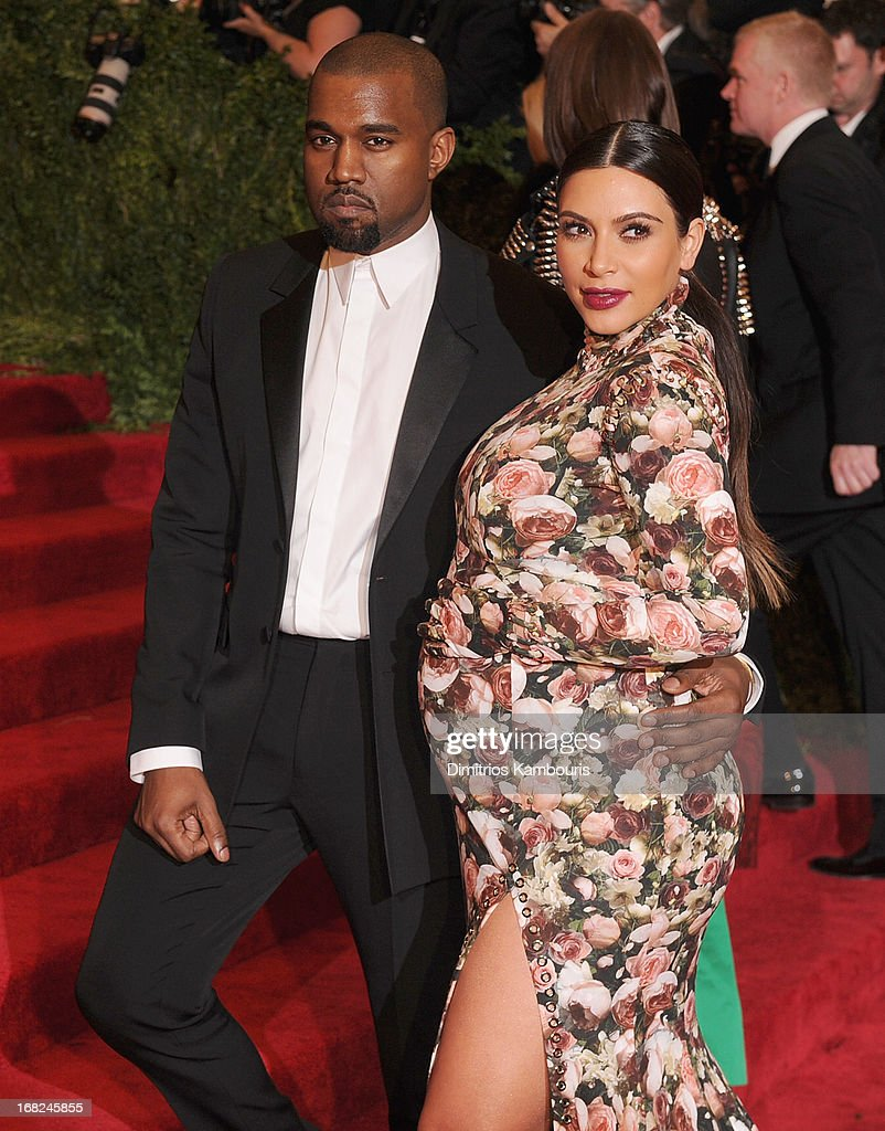 Kim Kardashian and Kanye West attend the 2013 Costume Institute Gala -