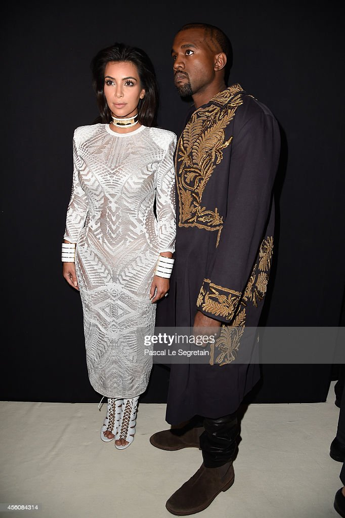 Kim Kardashian and Kanye West attend the Balmain show as part of the Paris Fashion Week Womenswear Spring/Summer 2015 on September 25 2014 in Paris...