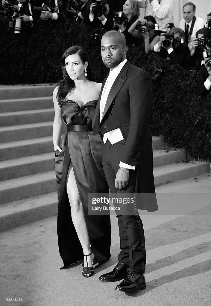 <a gi-track='captionPersonalityLinkClicked' href=/galleries/search?phrase=Kim+Kardashian&family=editorial&specificpeople=753387 ng-click='$event.stopPropagation()'>Kim Kardashian</a> (L) and <a gi-track='captionPersonalityLinkClicked' href=/galleries/search?phrase=Kanye+West+-+Musician&family=editorial&specificpeople=201803 ng-click='$event.stopPropagation()'>Kanye West</a> attend the 'Charles James: Beyond Fashion' Costume Institute Gala at the Metropolitan Museum of Art on May 5, 2014 in New York City.