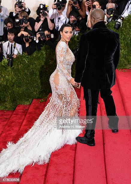 Kim Kardashian and Kanye West attend the 'China Through The Looking Glass' Costume Institute Benefit Gala at the Metropolitan Museum of Art on May 4...