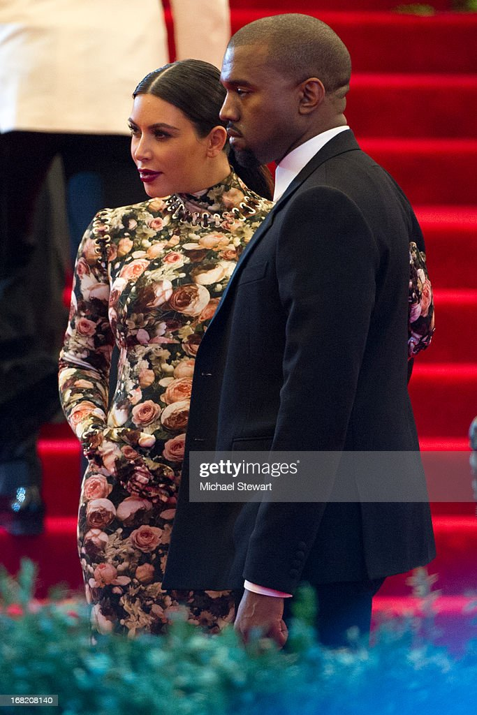 Kim Kardashian (L) and Kanye West attend the Costume Institute Gala for the 'PUNK: Chaos to Couture' exhibition at the Metropolitan Museum of Art on May 6, 2013 in New York City.