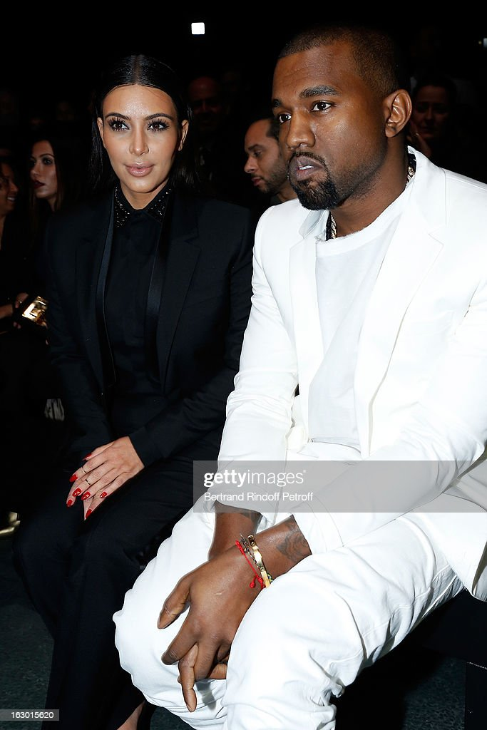 Kim Kardashian and Kanye West attend the Givenchy Fall/Winter 2013 Ready-to-Wear show as part of Paris Fashion Week on March 3, 2013 in Paris, France.