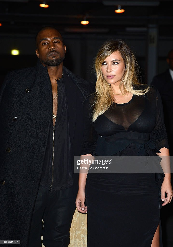 <a gi-track='captionPersonalityLinkClicked' href=/galleries/search?phrase=Kim+Kardashian&family=editorial&specificpeople=753387 ng-click='$event.stopPropagation()'>Kim Kardashian</a> and <a gi-track='captionPersonalityLinkClicked' href=/galleries/search?phrase=Kanye+West+-+Musician&family=editorial&specificpeople=201803 ng-click='$event.stopPropagation()'>Kanye West</a> attend the Givenchy show as part of the Paris Fashion Week Womenswear Spring/Summer 2014 on September 29, 2013 in Paris, France.