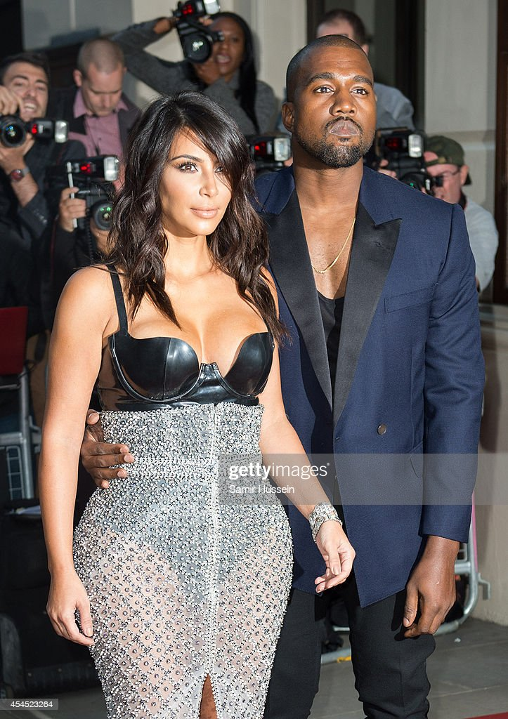 <a gi-track='captionPersonalityLinkClicked' href=/galleries/search?phrase=Kim+Kardashian&family=editorial&specificpeople=753387 ng-click='$event.stopPropagation()'>Kim Kardashian</a> and <a gi-track='captionPersonalityLinkClicked' href=/galleries/search?phrase=Kanye+West+-+Musician&family=editorial&specificpeople=201803 ng-click='$event.stopPropagation()'>Kanye West</a> attend the GQ Men of the Year awards at The Royal Opera House on September 2, 2014 in London, England.