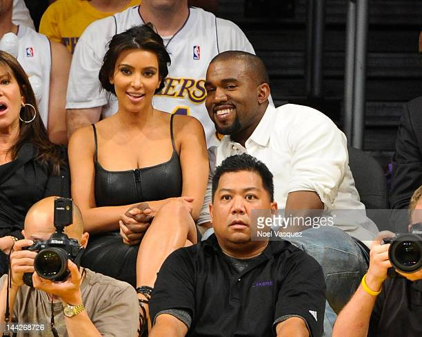 Kim Kardashian and Kanye West attend the Los Angeles Lakers and Denver Nuggets Game 7 of the Western Conference Quarterfinals in the 2012 NBA...