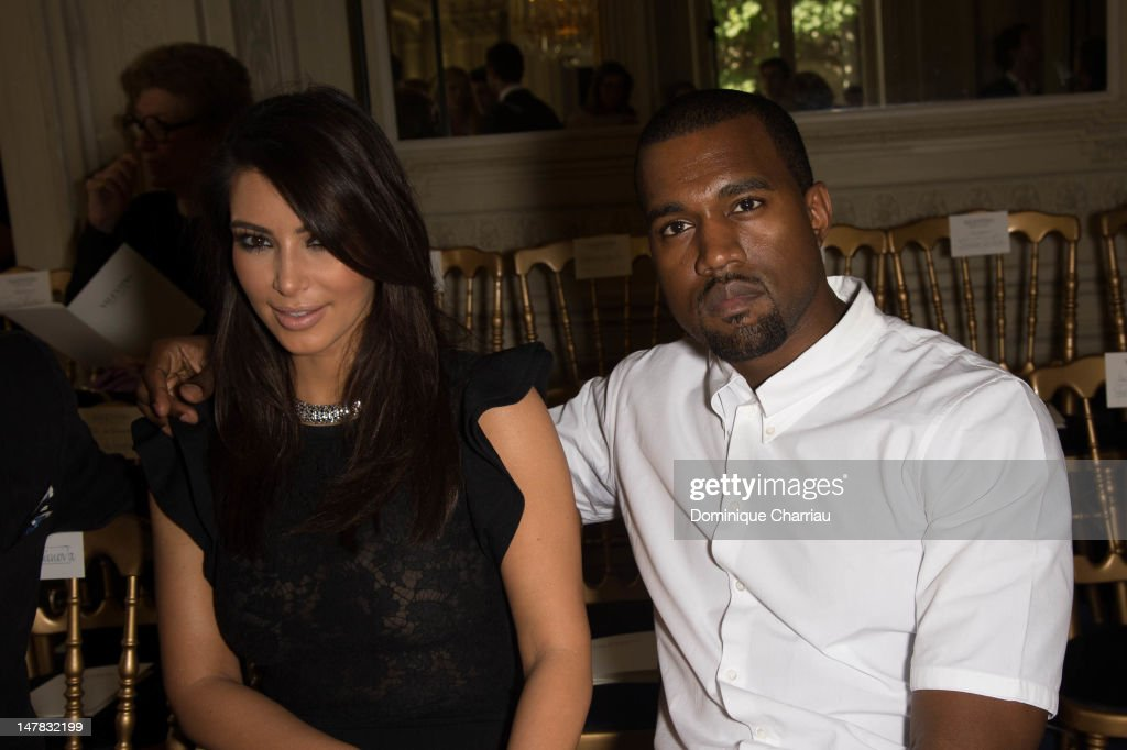 <a gi-track='captionPersonalityLinkClicked' href=/galleries/search?phrase=Kim+Kardashian&family=editorial&specificpeople=753387 ng-click='$event.stopPropagation()'>Kim Kardashian</a> and <a gi-track='captionPersonalityLinkClicked' href=/galleries/search?phrase=Kanye+West+-+Musician&family=editorial&specificpeople=201803 ng-click='$event.stopPropagation()'>Kanye West</a> attend the Valentino Haute-Couture Show as part of Paris Fashion Week Fall / Winter 2012/2013 at Hotel Salomon de Rothschild on July 4, 2012 in Paris, France.