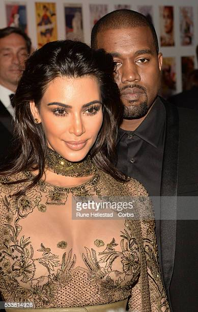 Kim Kardashian and Kanye West attend the Vogue 100 Gala Dinner at Kensington Gardens on May 22 2016 in London England