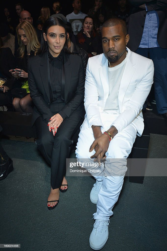 <a gi-track='captionPersonalityLinkClicked' href=/galleries/search?phrase=Kim+Kardashian&family=editorial&specificpeople=753387 ng-click='$event.stopPropagation()'>Kim Kardashian</a> and <a gi-track='captionPersonalityLinkClicked' href=/galleries/search?phrase=Kanye+West+-+Musicien&family=editorial&specificpeople=201803 ng-click='$event.stopPropagation()'>Kanye West</a> Givenchy Fall/Winter 2013 Ready-to-Wear show as part of Paris Fashion Week on March 3, 2013 in Paris, France.