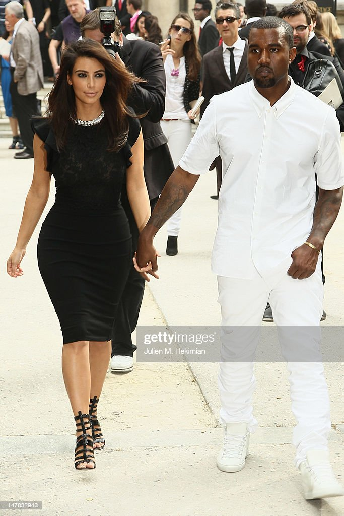 <a gi-track='captionPersonalityLinkClicked' href=/galleries/search?phrase=Kim+Kardashian&family=editorial&specificpeople=753387 ng-click='$event.stopPropagation()'>Kim Kardashian</a> and <a gi-track='captionPersonalityLinkClicked' href=/galleries/search?phrase=Kanye+West+-+Musician&family=editorial&specificpeople=201803 ng-click='$event.stopPropagation()'>Kanye West</a> leave the Valentino Haute-Couture Show as part of Paris Fashion Week Fall / Winter 2012/2013 at Hotel Salomon de Rothschild on July 4, 2012 in Paris, France.