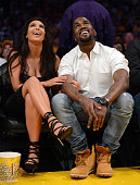 Kim Kardashian and Kanye West watch the video board from their courtside seats as the Los Angeles Lakers take on the Denver Nuggets in Game Seven of...
