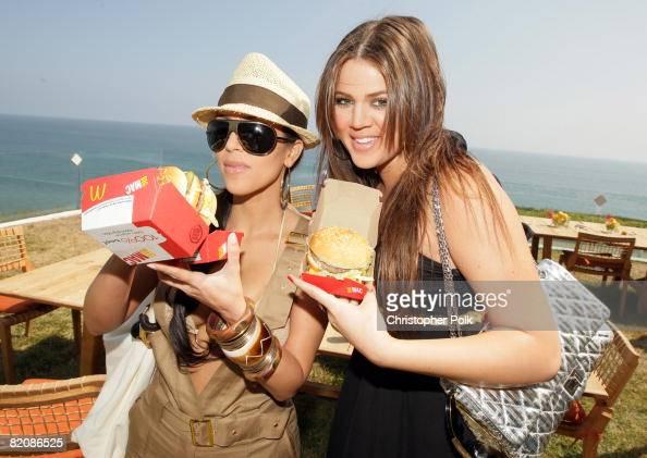 Kim Kardashian and Khloe Kardashian with McDonald's Big Mac during McDonald's Big Mac 40th Birthday Party at Project Beach House in Malibu CA on July...