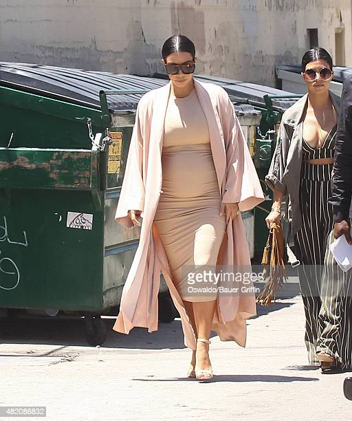 Kim Kardashian and Kourtney Kardashian are seen on July 26 2015 in Los Angeles California