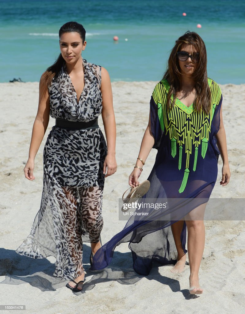 <a gi-track='captionPersonalityLinkClicked' href=/galleries/search?phrase=Kim+Kardashian&family=editorial&specificpeople=753387 ng-click='$event.stopPropagation()'>Kim Kardashian</a> and <a gi-track='captionPersonalityLinkClicked' href=/galleries/search?phrase=Kourtney+Kardashian&family=editorial&specificpeople=3955024 ng-click='$event.stopPropagation()'>Kourtney Kardashian</a> are sighted on October 3, 2012 in Miami, Florida.