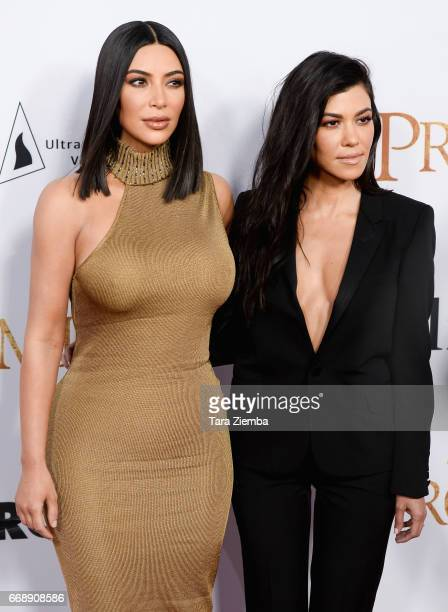 Kim Kardashian and Kourtney Kardashian arrive to the Los Angeles premiere of 'The Promise' at TCL Chinese Theatre on April 12 2017 in Hollywood...