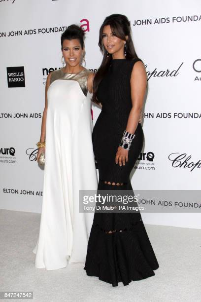 Kim Kardashian and Kourtney Kardashian arriving for the Elton John Aids Foundation Academy Awards Viewing Party at West Hollywood Park in Los Angeles...