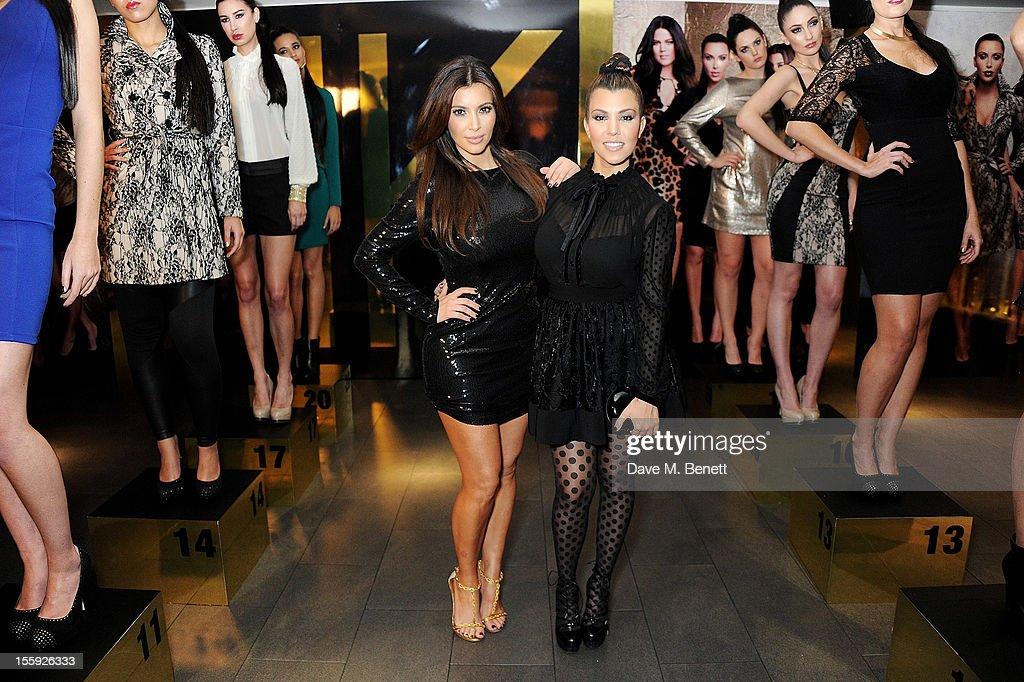 Kim Kardashian (L) and Kourtney Kardashian attend the Kardashian Kollection launch for Dorothy Perkins at Aqua on November 8, 2012 in London, England.